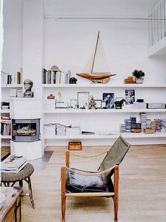 I like the built in shelving painted white to blend in and while I don't like the angled finishes I thought this demonstrated a fireplace coming out into the room...