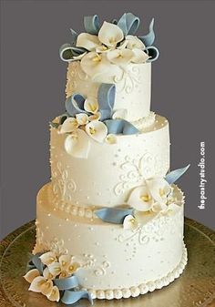 White on White Three-Tier with White Flowers and Pale Blue Bows