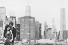 Laura & Jason during their engagement session in DUMBO Brooklyn. Captured by NYC wedding photographer Ben Lau.