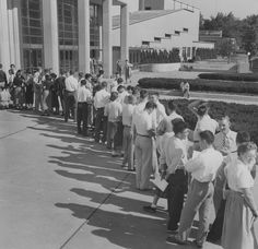 Waiting in line outside Memorial Coliseum to register for classes. Circa 1956.