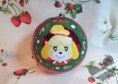 Animal Crossing Ornament!  I loved this picture of Isabelle! So I made a few tiny tweeks and painted it on a wonderfull red ornament! I love it so much <3