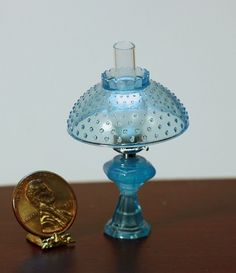 Dollhouse Miniature Oil Lamp with Hobnail Shade in Ice Blue | eBay    Non-Electric. Looks just like Hobnail depression glass! Chrysnbon Miniature Products are all beautifully handcrafted in the USA of polystyrene. Measures: 1 3/8 in wide at the widest point x 1 7/8 in tall. Designed for the 1:12 scale miniature setting.