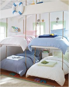 Swinging from the ropes. I love this bunk room for girls