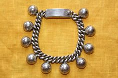 vintage La Cucaracha ball linked mexican silver by abroochable, $440.00