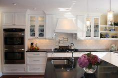 Love the shaker style white cabinets, black granite, island, would add dark hardwood.