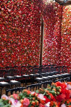 set design for Christian Dior's fall 2012 couture show. Flower arrangement wall. Design by Kelsey