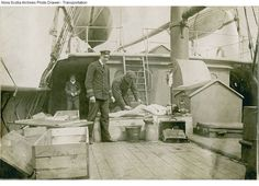 Body of RMS Titanic victim aboard rescue vessel CS Minia being made ready for make-shift coffin.