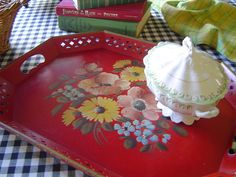 I have this red tole tray and just love it.  I bought it an  Estate sale this year.