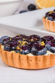 Dive into these stunning blueberry custard tarts, topped with fresh, plump berries and a homemade blueberry compote. Sweet Pie, Sweet Tarts, Tart Recipes, Baking Recipes, Lemon Custard Tart, Blueberry Compote, Blueberry Desserts, Great British Chefs, Dessert Spoons