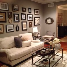 Living room gallery wall - would look good in the basement.