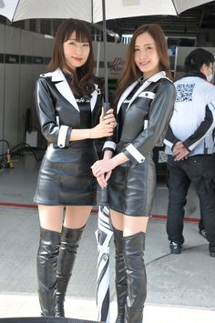 Asian promo girls in leather jackets skirts and OTK boots