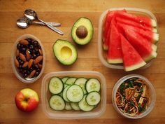 picnic lunch for two: almonds & dark chocolate espresso beans, gala apple, avocado, cucumber slices, watermelon slices, spicy tofu noodle salad