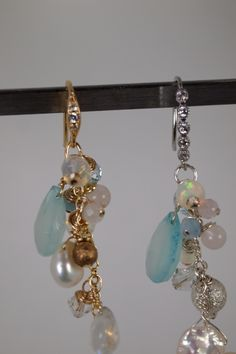 Beautiful genuine aquamarine multigemstone cluster earrings with rainbow moonstone, fire opal, pink morganite, rose quartz, swarovski bicone crystals and metal beads, sterling silver or gold filled wire hoops and rings. Beautiful ornate ear hooks with CZ, handmade and designed by ZahidasJewellery #gemstone jewelry #gemstone earrings dangle #gemstone earrings gold #gemstone jewelry diy