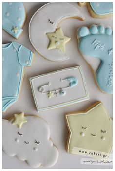 Baby shower cookies~ White cloud cookies, yellow moon cookies, blue baby feet cookies, star cookies, newborn cookies, evil eye cookies, Onesie. By zahari productions, diaper pin, baby cap