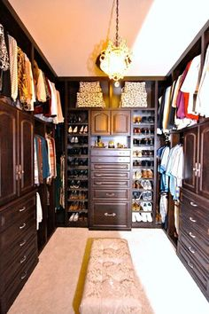 Such a great example by Closet Factory Houston showing how to utilize all the space in an extra tall closet. You can use the top row of hanging for out of season storage, and add pull down rods or a library ladder for easy access. Not only does it fully utilize all the space it does it beautifully with decorative faces. Nice job!