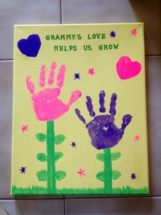 Made this for Mother's Day :) handprints for flowers and thumbprints for leaves :)