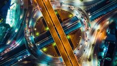 Ad: Beautiful top view time-lapse of car traffic at roundabout lane and buildings. drone aerial zoom out. Urban cityscape concept or abstract of advanced innovation, financial technology, energy power Global Stock Market, Phone Screen Wallpaper, Cinema Camera, 42nd Street, Aerial Drone, Night City, Imagines, White Sand Beach, Video Footage