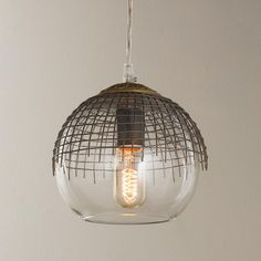 Urban Metal Grid Pendant The rustic metal grid overlay adds an urban feel to this simple glass globe pendant. The solid brass decorative cap on top of the grid gives a vintage feel. Group several together in different heights for a unique look over a farm table or kitchen island. Blends well with industrial style