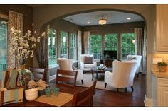 An elegant arched entry leads to windows that frame green trees. An idyllic setting: new homes in The Weddington Trace Preserve Collection. Standard Pacific Homes. Waxhaw, NC.