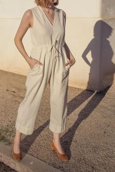 Our favorite jumpsuit in a new color! V-neck sleeveless jumpsuit with back slit opening, drawstring at waist, pockets and relaxed fit. Length hits above ankle when rolled. Made with love in Peru. We closely monitor our Peruvian production, working only with ethically sound, women-owned factories. CONTENT & CARE:100% washed pima cotton (woven)Machine wash cold, lay flat or hang to dry