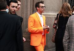 The stylist, Brad Goreski in Milan (Menswear Spring/Summer 2012 fashion week) with an orange Jil Sander suit.