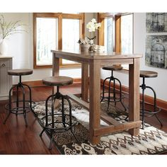 Signature Design by Ashley Pinnadel 5-piece Bar Set with Tall Swivel... ($1,087) ❤ liked on Polyvore featuring home, furniture, stools, barstools, brown, colored stools, brown stool, colored furniture, rectangular pub table and brown bar stools
