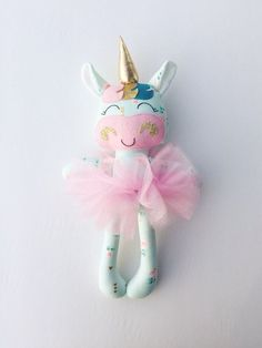 This unicorn doll is made with love! She is about 15 inches tall not including her horn and made from high quality cotton fabrics and wool blend felt accessories. Her face is hand embroidered. Her outfit consists of a removable pink tutu. Extra outfits can be purchased to dress