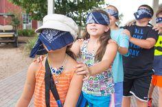 Blind folded trust walk at Camp Tejas in Giddings, TX