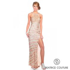 BB8923  An alluring long gown covered in hand work with a deep coweled back.