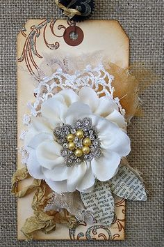 Gorgeously dimensional handmade tag in a lovely pale palette.