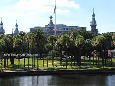 The University of Tampa (UT) in Tampa, FL, sits adjacent to the Hillsborough River, offering picturesque views of downtown Tampa. A popular gathering spot, the UT dock is behind the boathouse and is used by the UT rowing team. Students can be found studying by the riverfront, watching boats pass by.