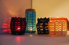image of Moroccan inspired crochet votive and jar cosy with lit candles