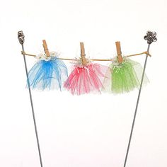 Fairy garden washing line with fairy skirts pegged to it