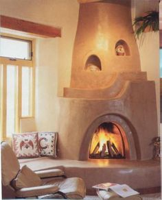 The Kiva Fireplace . Steppin' Up & Out, Southwest Style! Southwestern Home, Home, Adobe Fireplace, Cob House, New Homes, Southwest Style, Corner Gas Fireplace, Southwest House, Fireplace