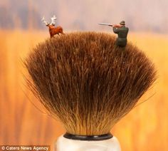 while 'Shaving Brush Savannah' shows a man wading through the 'grass' of a brush to hunt down a stag