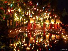 monks release sky lanterns during the Yi Peng Lantern Festival at Wat Phan Tao in Chiang Mai