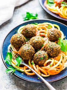 Easy Vegetarian Lentil Meatballs. Try them with pasta noodles, inside a sub for a sandwich, or with spiralized veggie noodles too! Recipe calls for carrots, but you can also use mushroom or any other vegetable you love. Recipe at wellplated.com | @wellplated