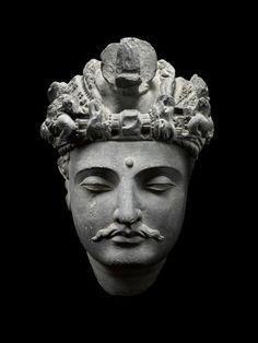 Head of a Bodhisattva. Pakistan, Northwest Frontier. Gandhara, 3rd/4th Century A.D. Gray Schist. Height: 11 inches (27.9 cm).