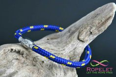 Blue and yellow Ropelet,  one of our collection of handmade rope and leather bracelets made just for you at www.ropelet.co.uk.  Check out our ranges, only made to your order as we give you the choices of how you want it made.  Great prices, huge choice with amazing customer service, thats Ropelet.  www.ropelet.co.uk  #ropelet #ropebracelet #bracelet #wristband #menswear #menstyle #mensbracelet #style #wristwear #ladiesbracelet #livecolorfully #climbingbracelet #skateboarding #snowboarding