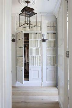Traditional Entryway with flush light, High ceiling, Built-in bookshelf, Crown molding, specialty door, Hardwood floors