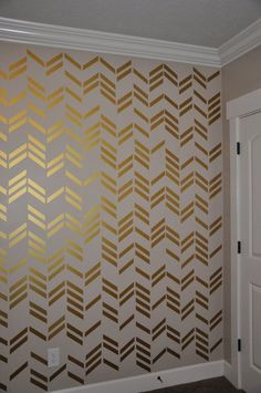 Gold Herringbone tape design on wall.