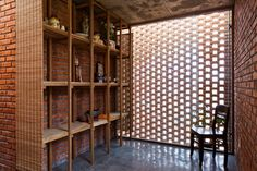 Passively-cooled Termitary House in Vietnam is wrapped in perf...