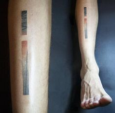Abstract shin tattoo.