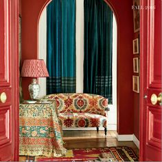 Carolina Irving's Paris apartment, luxe layers interior design, textures with textiles, fabric mix, pattern mix fabric combos, rooms with rugs, layered textiles/fabric, world of interiors, bohemian home decor, old world interiors,