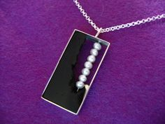 Pendant in the series Black&Pearls; Ebony, silver and pearls by Akkasilver