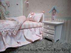 Dollhouse miniature 1/12th scale twin size shabby cottage bed and bedding set in pink. $38.00, via Etsy.