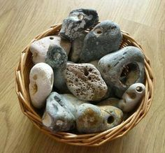 "Hag Stones: Hag stones are stones that have a naturally occurring hole inside them. These stones are often found along the coastal points, beaches, and streams. These holes occur from the elements beating down upon them over many years, though there are speculations that these mysterious stones may have been formed by a ""worm hole"". Hag stones were also known as Witch Stones or Holey Stones."