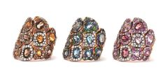 Rodney Rayner 18ct red gold Via Roma 'band' rings with: citrines and smokey quartz, pave orange sapphires, champagne diamonds and diamonds (left); blue topaz, blue sapphires and blue tsavorites (centre); and rhodollites, rose amethysts, pave pink sapphires, champagne diamonds and diamonds (right)