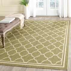 Give yourself the perfect place to sit and relax by the pool with this dramatic indoor-outdoor rug. Shades of green and beige complement your outdoor furniture, and the rug is resistant to almost all outdoor problems, including water, sun, and mold.