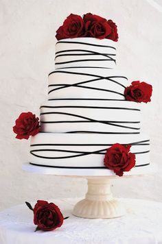 A-symmetrical stripes and natural roses make for a sweet and simple wedding cake.